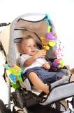behandla som ett barn den lyckliga strolleren Royaltyfri Fotografi