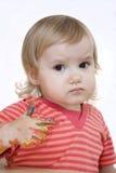 behandla som ett barn den målade handen Arkivbild