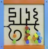 Behandla som ett barn den Maze Educational leksaken Arkivfoton