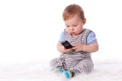 behandla som ett barn den små sötsaken för den mobila telefonen Arkivbilder