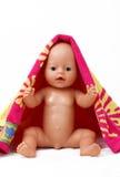 behandla som ett barn - dockan Arkivfoto
