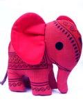 behandla som ett barn elefanttoyen Arkivfoto