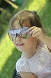 behandla som ett barn exponeringsglassunen Arkivbilder