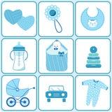 Behandla som ett barn födda symboler i blåttfärg Arkivbild