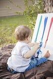 Behandla som ett barn fingerpainting Arkivbilder
