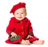 Behandla som ett barn flickan i juldräkt på vit bakgrund Arkivfoto