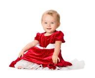 Behandla som ett barn flickan i juldräkt på vit bakgrund Arkivfoton