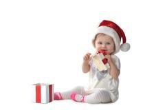Behandla som ett barn flickan i jultomtenhatt Royaltyfria Foton