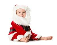 Behandla som ett barn flickan i Santa Claus Costume på vit bakgrund Royaltyfria Bilder