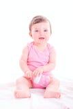 Behandla som ett barn flickan med rosa färger behandla som ett barn flaskan Royaltyfria Bilder