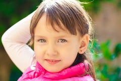 behandla som ett barn flickapinken royaltyfri fotografi
