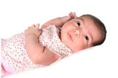 behandla som ett barn flickaspädbarn som ser upp arkivfoton