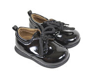 behandla som ett barn formella blanka skor Arkivbilder