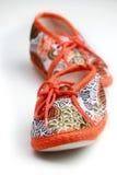 behandla som ett barn gulliga skor Royaltyfri Bild