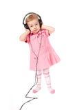 behandla som ett barn hörlurar Royaltyfri Foto