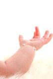 behandla som ett barn hand öppet s Arkivfoton