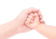 Behandla som ett barn handen - in - handen av förälskelse som isoleras på vit bakgrund Royaltyfri Bild