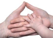 behandla som ett barn handhänder som rymmer föräldrar s Royaltyfri Fotografi