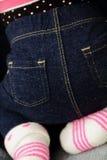 Behandla som ett barn i jeans Arkivbilder