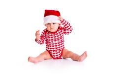 Behandla som ett barn i Santas hatt Arkivfoto