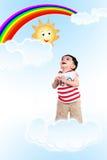 Behandla som ett barn i skyen arkivfoton
