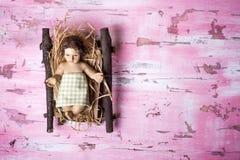 Behandla som ett barn Jesus i hans lathundjulkort Arkivbild