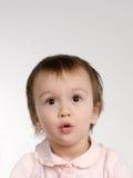 behandla som ett barn joyful förvånadt för flicka Royaltyfri Foto