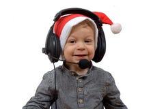 Behandla som ett barn jul med hörlurar arkivfoton