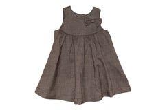 behandla som ett barn klänningen Arkivfoto