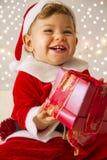 Behandla som ett barn klätt som Santa Claus Arkivfoton