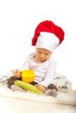 Behandla som ett barn kocken med grönsaker Arkivbild