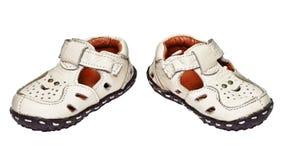 behandla som ett barn äktat läder som göras skor Arkivfoton