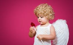 Behandla som ett barn kupidonet Fotografering för Bildbyråer