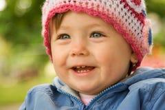 behandla som ett barn le slitage för hatt Arkivbilder
