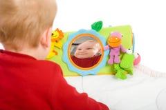 behandla som ett barn leka toys för pojken Arkivfoto