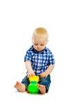 behandla som ett barn leka toys för pojken isolerat Arkivbilder