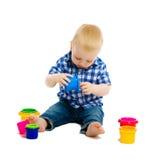 behandla som ett barn leka toys för pojken isolerat Arkivfoto