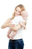 behandla som ett barn lyckliga händer henne moderbarn Arkivbilder