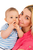 Behandla som ett barn lyckliga pressar för en moder stramt Fotografering för Bildbyråer