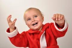 behandla som ett barn lyftt lyckligt för julhänder Arkivbild