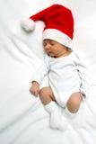 Behandla som ett barn med den Jultomte hatten Arkivfoto