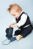 Behandla som ett barn med headphonen Royaltyfria Foton