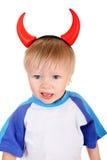 Behandla som ett barn med jäkelhorn Arkivfoton