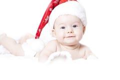 Behandla som ett barn med jultomtenhatten Arkivfoto
