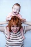 behandla som ett barn modern Royaltyfri Foto