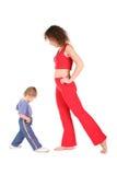 behandla som ett barn modersporten Arkivbilder