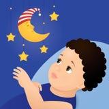 Behandla som ett barn och den mobila måneleksaken Arkivbild