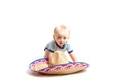Behandla som ett barn och sombreron på vit Arkivfoto