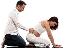 behandla som ett barn par som förväntar massage Arkivbild