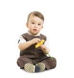 Behandla som ett barn pojken med blomman, väl påkläddunge i dräkt Retro stil för barn, ett årigt barn Arkivbild